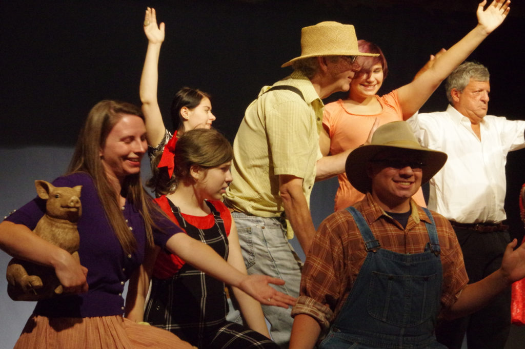 This weekend the Opera House will once again host a stellar cast of local thespians as they perform in Lil Abner. Robert Willey will play the title role of Abner as Daisy May (played by Heather Wilson) tries to win his reluctant heart. Brent Garrow and Rebecca Anne Bennett play the roles of Pappy and Mammy who connive to lead their son in the right direction. The play, directed by Kathleen Hoffman and choreographed by Molly Hartman, runs from Thursday, July 28  through Sunday, July 31. The curtain will go up at 7:00 Thursday, Friday, and Saturday, and at 2:00 on Sunday. Come and enjoy.