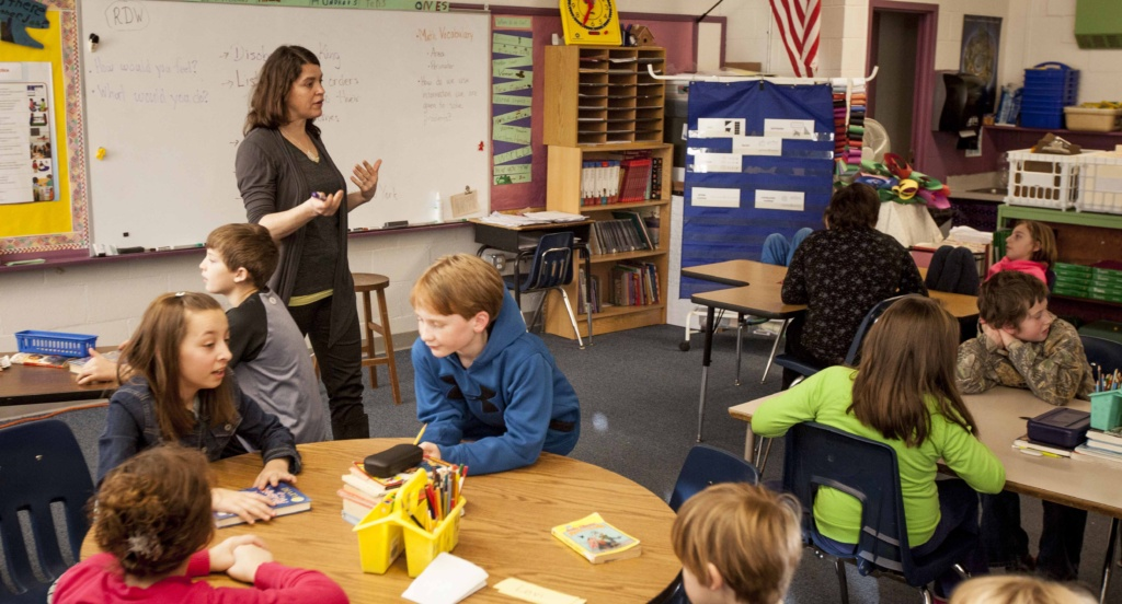 Mary Ellis works with her fourth grade students in this file photo from 2014.